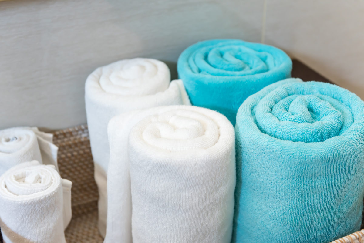 photo of rolled towels in a basket